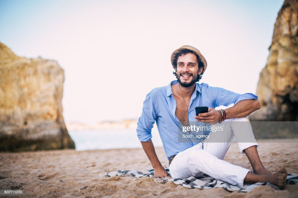 Enjoying music at coastline : Stock Photo