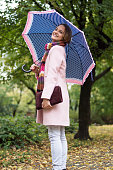 beautiful young woman enjoying rainy day