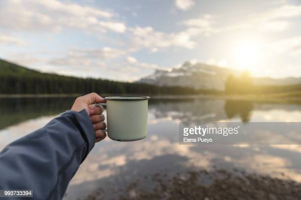 Enjoying nature with a hot coffee  or tea