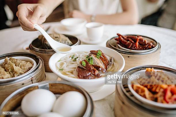 Enjoying noodles and variety of dim sum
