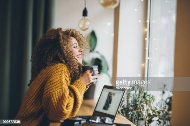 enjoying of work and coffee - sweater stock pictures, royalty-free photos & images