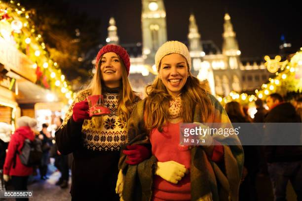 enjoying on christmas market - town hall square stock pictures, royalty-free photos & images