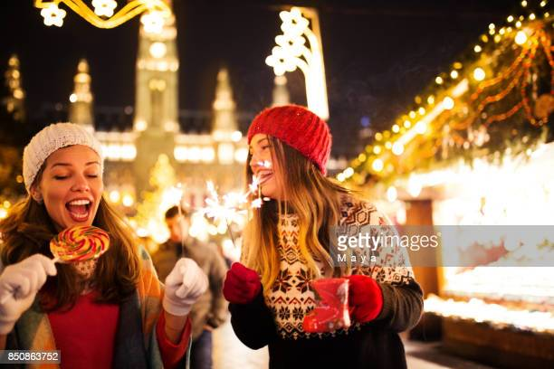 enjoying on christmas market - christmas market stock pictures, royalty-free photos & images