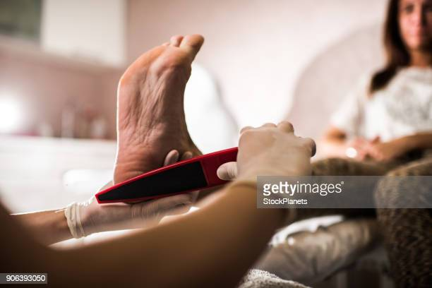 enjoying pedicure - pedicure stock pictures, royalty-free photos & images