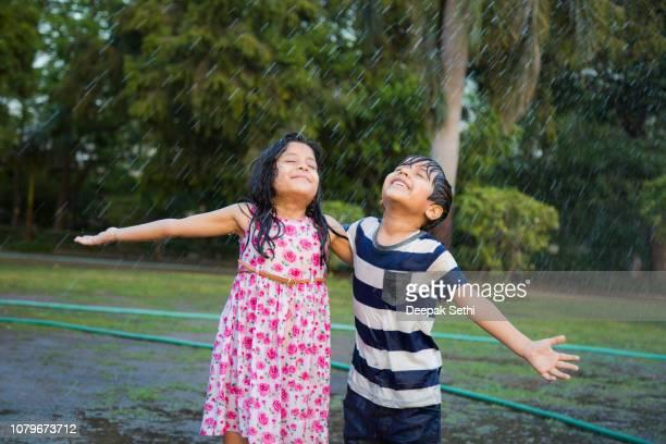 enjoying rain - stock image - rain stock pictures, royalty-free photos & images