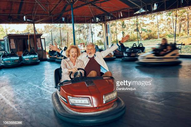 enjoying retirement - freaky couples stock photos and pictures
