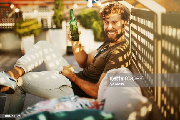 enjoying rooftop party and summer days. - beer alcohol stock pictures, royalty-free photos & images