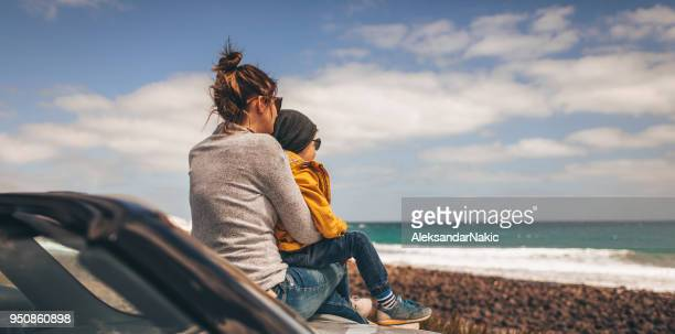 enjoying seaside view with my mom - happy family in car stock photos and pictures