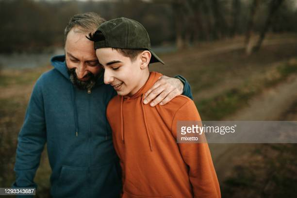 enjoying some father-son time - family with one child stock pictures, royalty-free photos & images