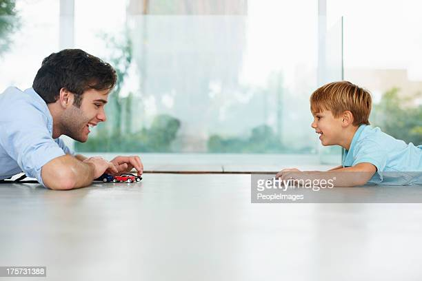 enjoying some father-son time - flooring stock photos and pictures