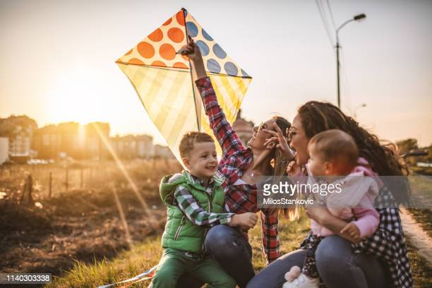 enjoying some precious bonding time together - kite toy stock pictures, royalty-free photos & images