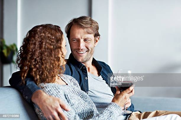 enjoying some time together and some fine wine - mid adult couple stock pictures, royalty-free photos & images