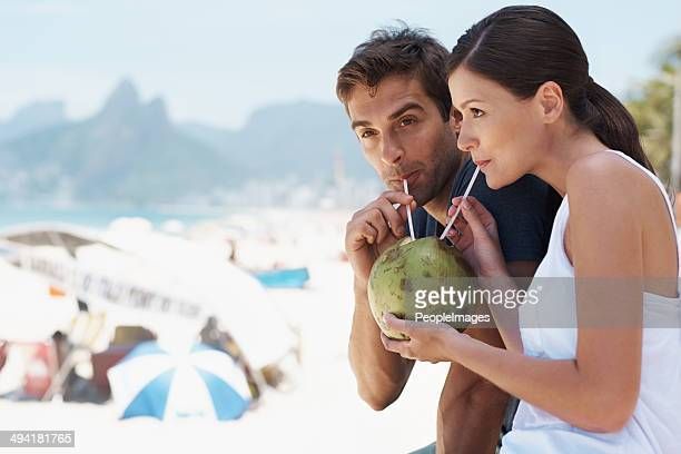 enjoying something new with the person i love - coconut water stock pictures, royalty-free photos & images