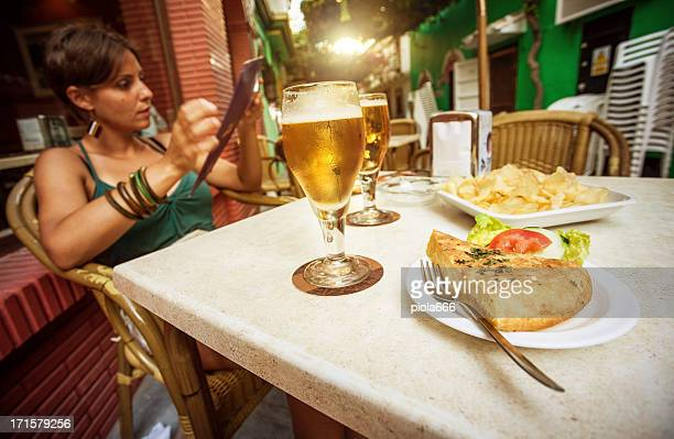 enjoying spanish tapas and beer - barcelona vs sevilla stock photos and pictures
