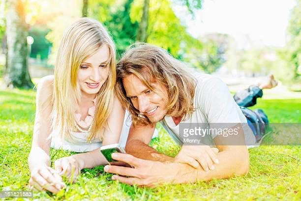 enjoying summer modern couple internet surfing - mlenny stock pictures, royalty-free photos & images