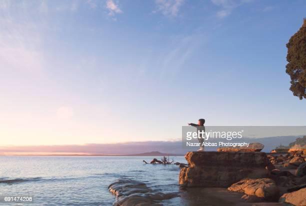 Enjoying Sunrise At Beach.