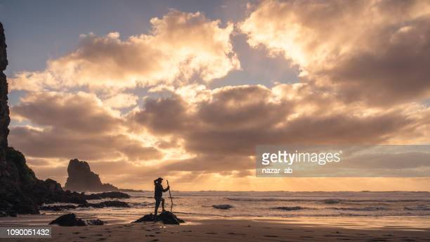 enjoying sunset at beach. - minority groups stock pictures, royalty-free photos & images