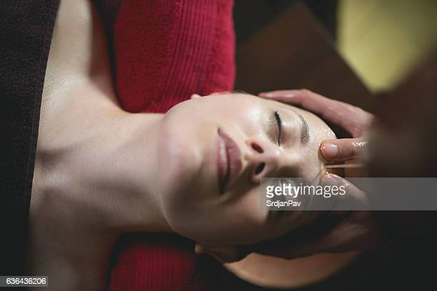 enjoying that healing touch - massage parlour stock photos and pictures