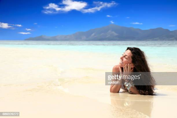 enjoying the beach - asian swimsuit models stock photos and pictures
