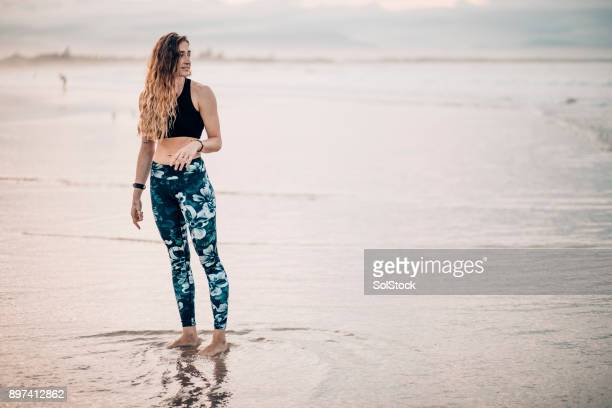 enjoying the beach - yoga pants stock photos and pictures