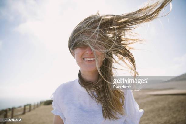 enjoying the fresh sea air - windswept stock pictures, royalty-free photos & images