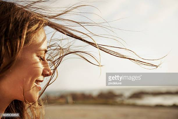 enjoying the fresh sea air - beautiful woman stockfoto's en -beelden