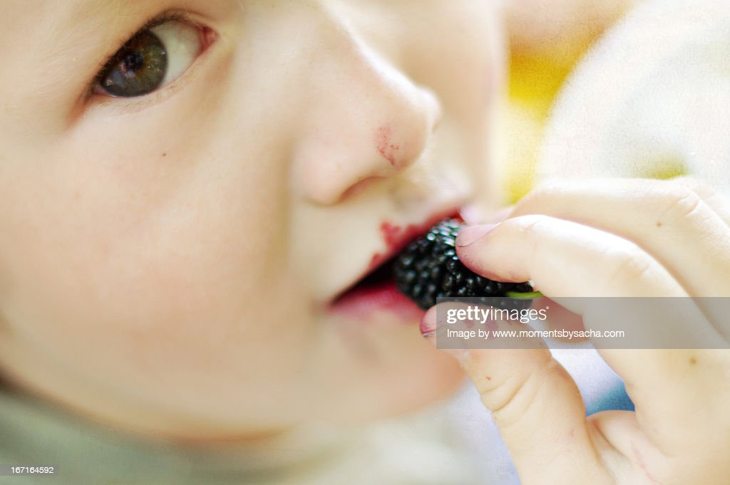 Enjoying the fruit : Stock Photo
