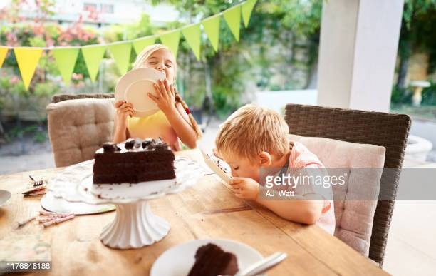 enjoying the last bit a cake - happy birthday images for sister stock pictures, royalty-free photos & images