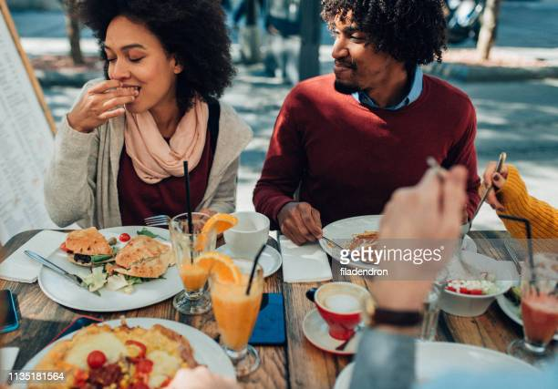 enjoying the meal outdoor - the brunch stock pictures, royalty-free photos & images