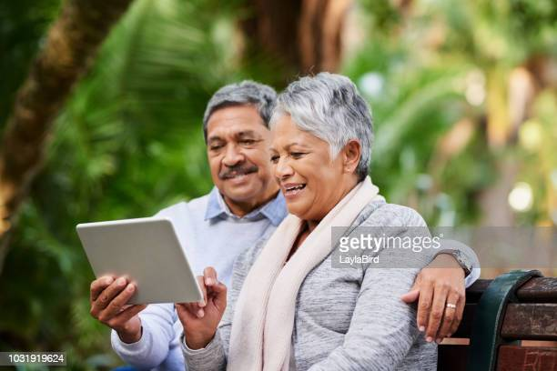 enjoying the mobility of connectivity - ira stock photos and pictures