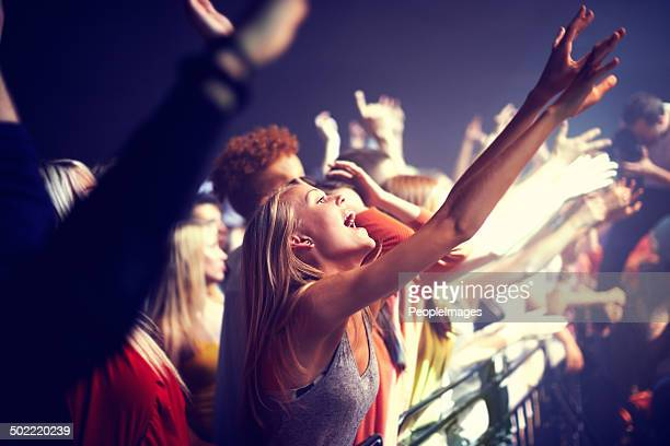 enjoying the music - music festival stock pictures, royalty-free photos & images