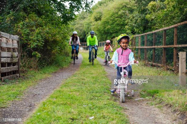 enjoying the park on bikes - riding stock pictures, royalty-free photos & images