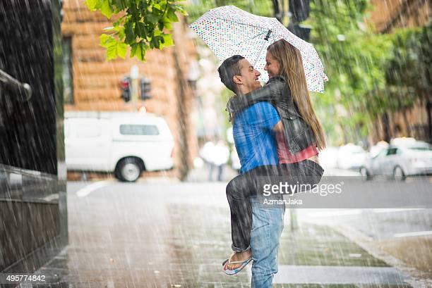 enjoying the rain - romantic rainy day stock photos and pictures
