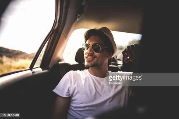 Enjoying the road trip on the backseat