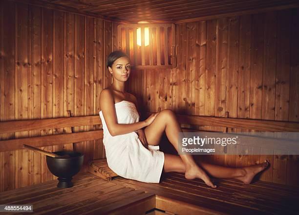 enjoying the sauna - black woman in sauna stock pictures, royalty-free photos & images