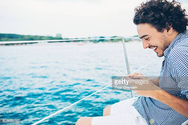 Enjoying the sea travel and texting