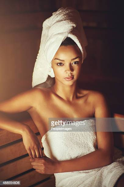 i enjoying the silence of the sauna - black woman in sauna stock pictures, royalty-free photos & images