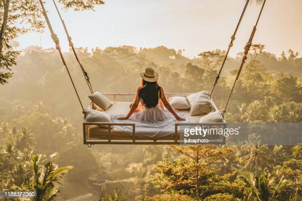 enjoying the spectacular views - swinging stock pictures, royalty-free photos & images