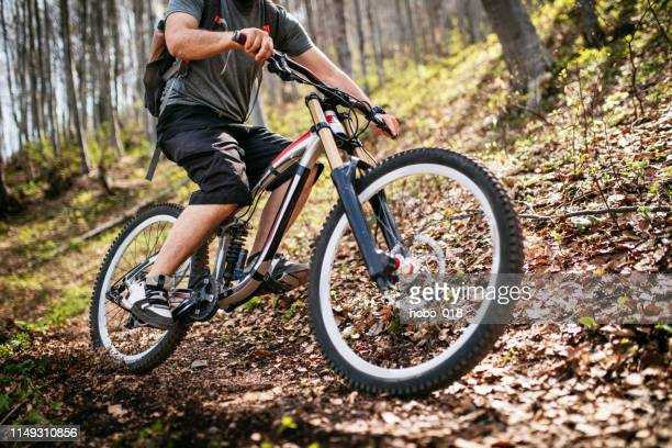 enjoying the speed on downhill cycling - downhill skiing stock pictures, royalty-free photos & images
