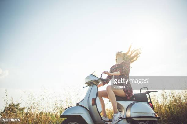 enjoying the summer on motorbike - moped stock photos and pictures