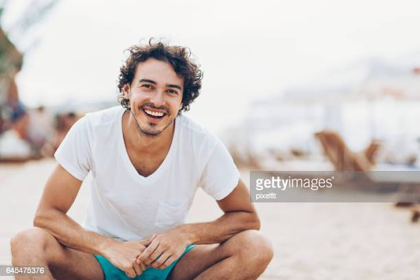 enjoying the summer on the beach - young men stock pictures, royalty-free photos & images