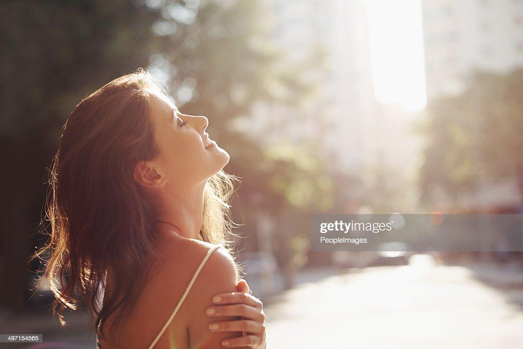 Enjoying the sun on her skin : Stock Photo