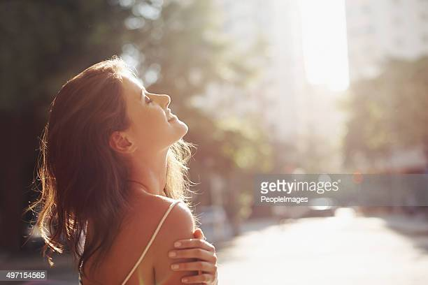 enjoying the sun on her skin - suns stock photos and pictures