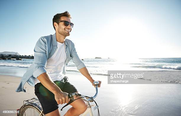 enjoying the therapeutic feelings of the sea - sunglasses stock pictures, royalty-free photos & images