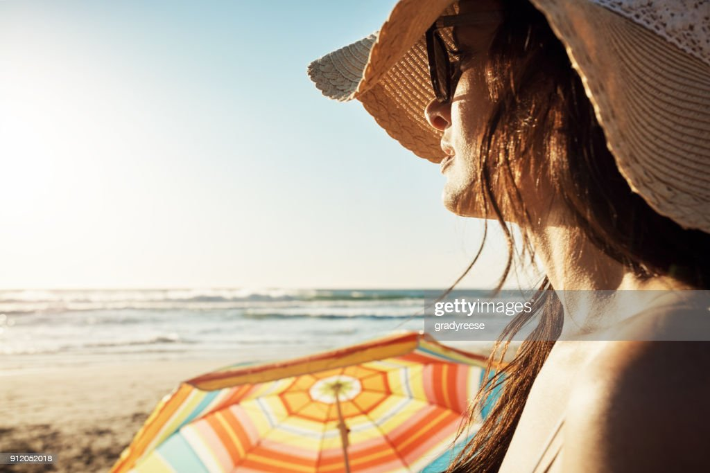 Enjoying The Tranquility At Beach Stock Photo