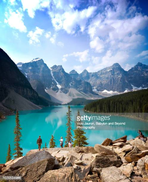 enjoying the view of lake moraine and valley of ten peaks - moraine lake stock pictures, royalty-free photos & images