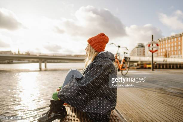 enjoying the view - nyhavn stock pictures, royalty-free photos & images