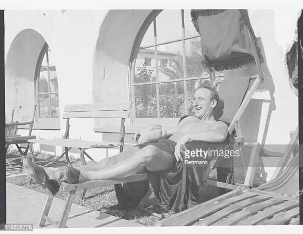 Enjoying the Warm Sun at Palm Springs. Palm Springs, California: Jimmy Durante enjoying the warm sunshine at El Mirador Hotel, Palm Springs,...