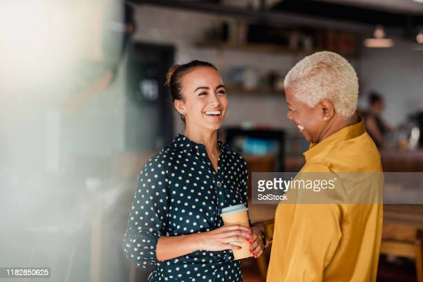 enjoying their breaks together - ethnicity stock pictures, royalty-free photos & images