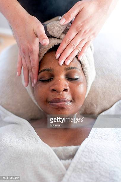 enjoying this treatment so much - massage black woman stock photos and pictures